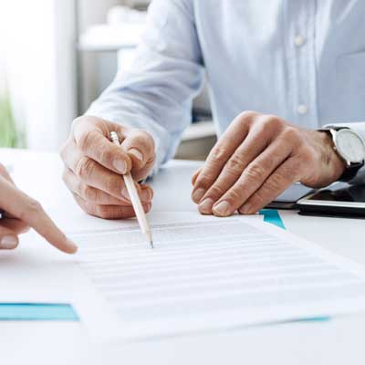 two people going over document