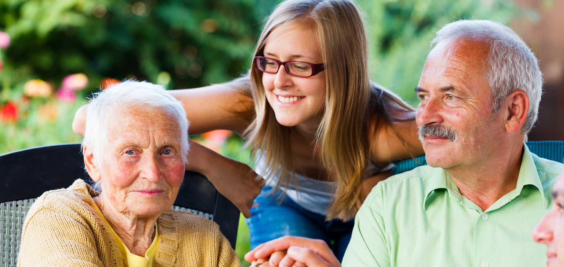 elderly couple and granddaughter