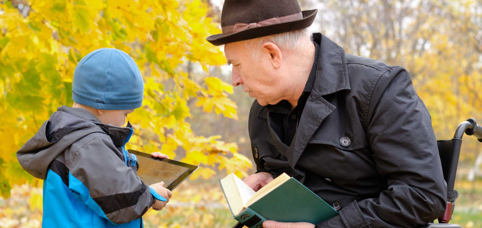 Grandson and grandfather reading books
