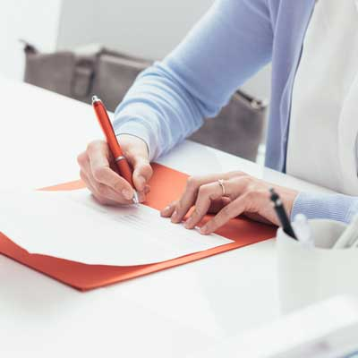 woman signing documents